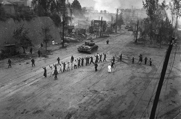 766px-M26_Pershing_escorts_POWs_in_the_Korean_War