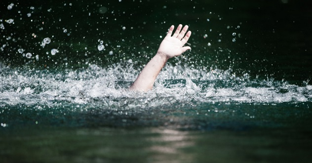 Hand of Someone Drowning and in Need of Help