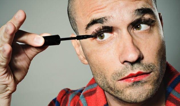 9a-man-applying-mascara-108219338