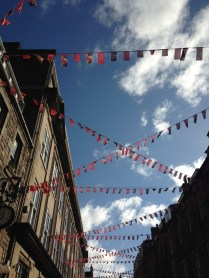 blue skies celebrating the Edinburgh book festival and Fringe with bunting
