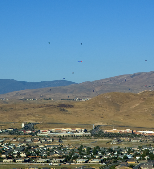 Plane flying close to the hot air balloons in Reno