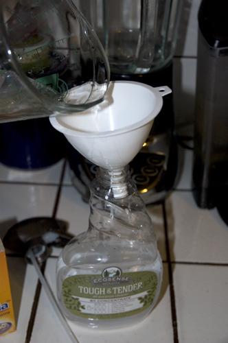 adding vinegar to spray bottle