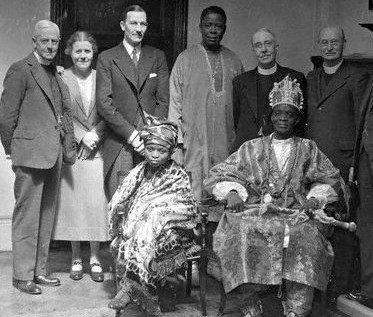 1937, London, England, UK --- His Royal Highness Samuel Ademola II, 7th Alake of Abeokuta with his daughter at the Methodist Missionary Society in London. --- Image by © Hulton-Deutsch Collection/CORBIS