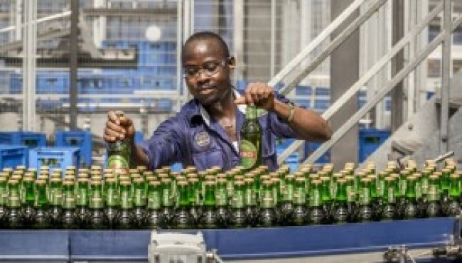 Commerce in Nigeria here illustrated with production of Oh Mpa, a SABMiller Plc brand