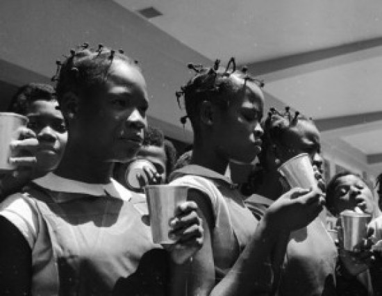 Socialism in action- Queen's College students taking routine milk diet provided by Government in Yaba