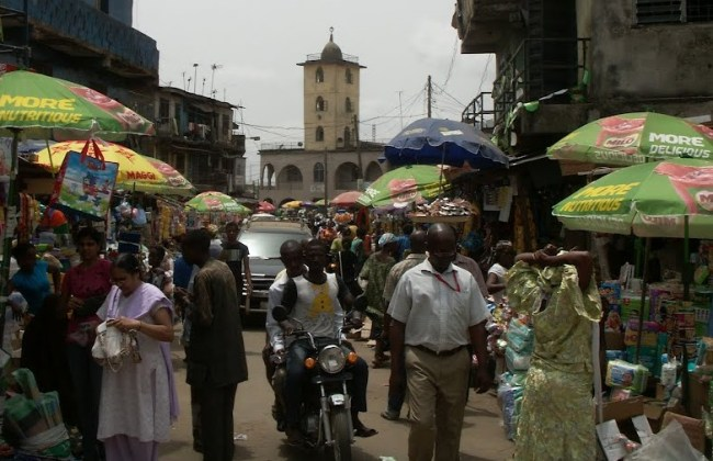 Street life in Mushin with a mosque at the back