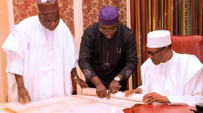 Kayode Fayemi briefing the President Buhari on the discovery of nickel in parts of Kaduna State.