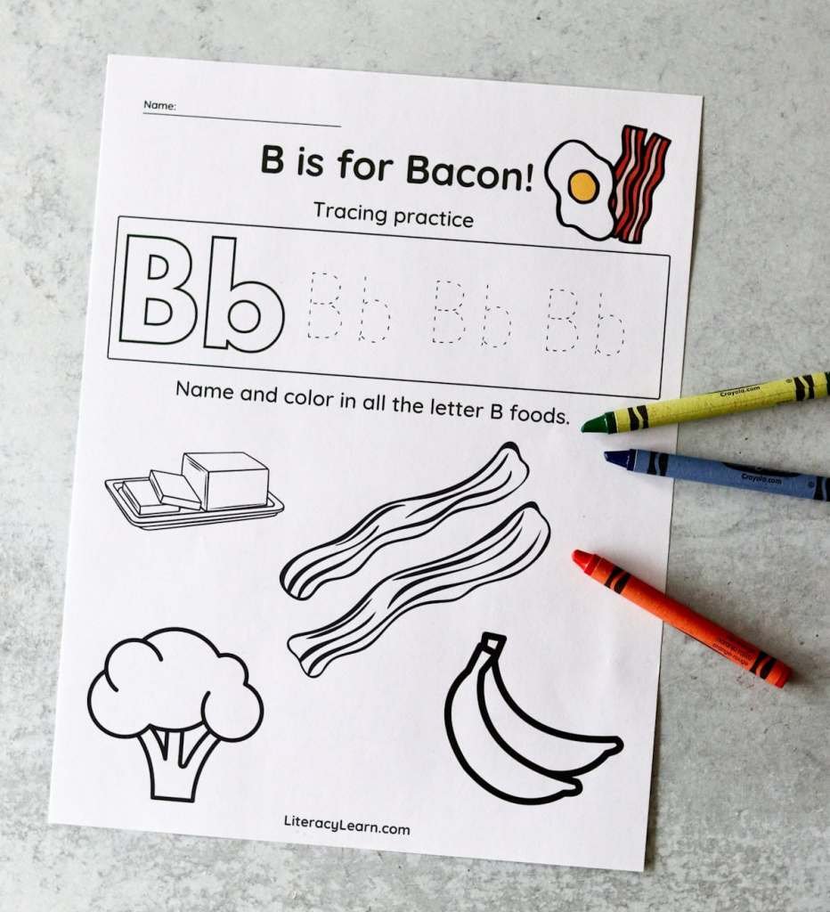 The B is for bacon worksheet on a table with a few crayons.