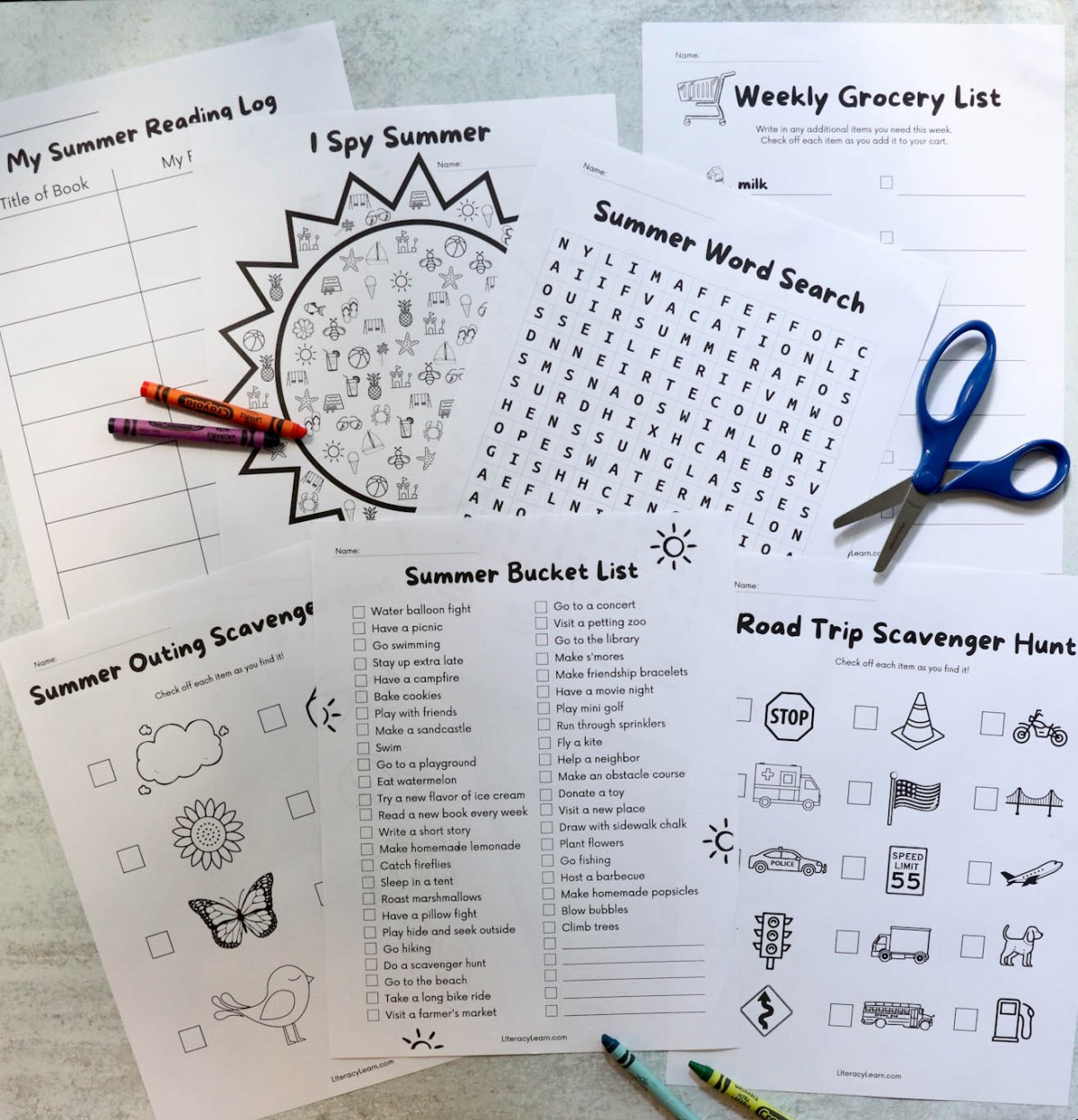Top down photo of the worksheets surrounded by scissors and crayons.