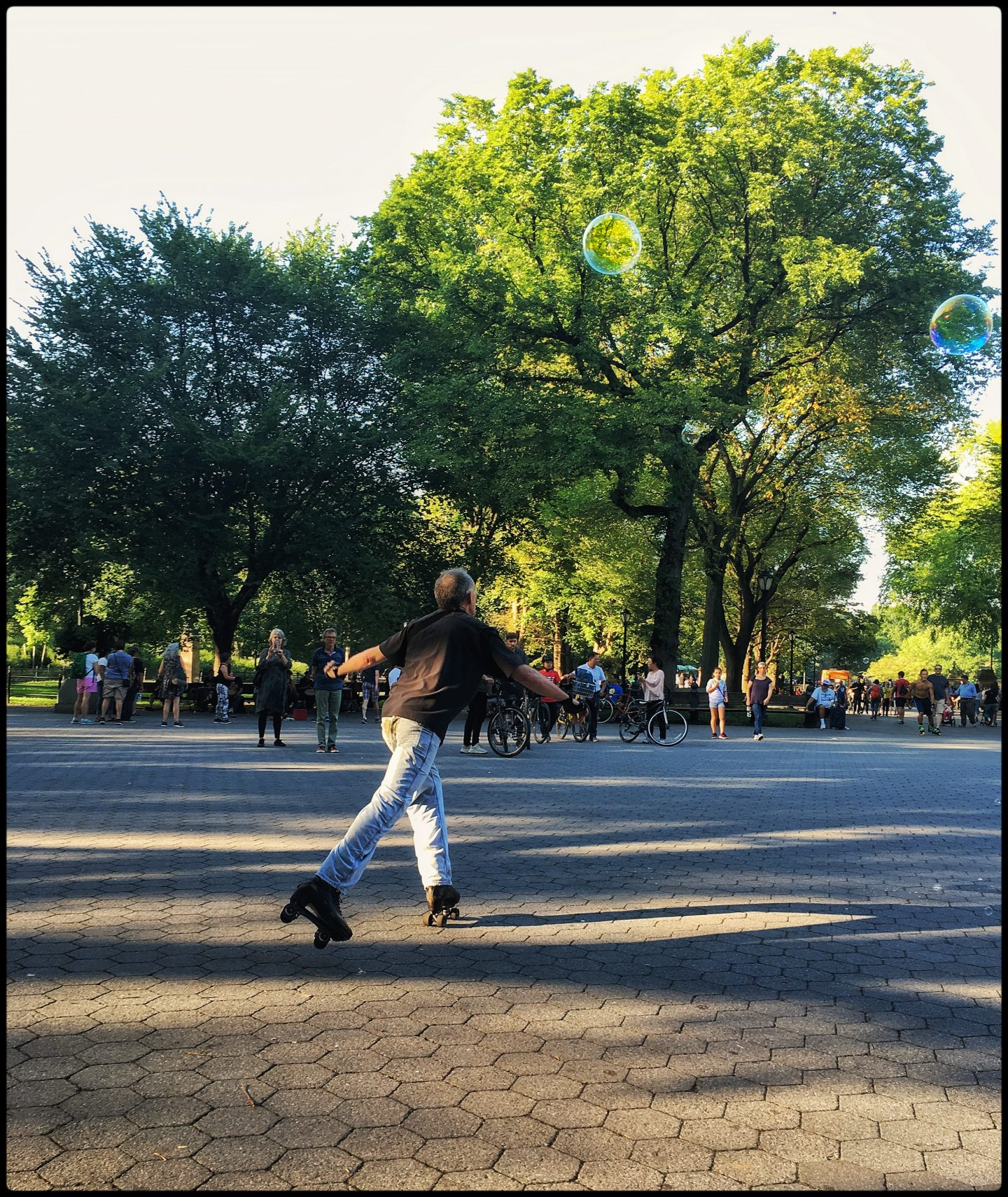 Guy dancing in the Park on rollerblades