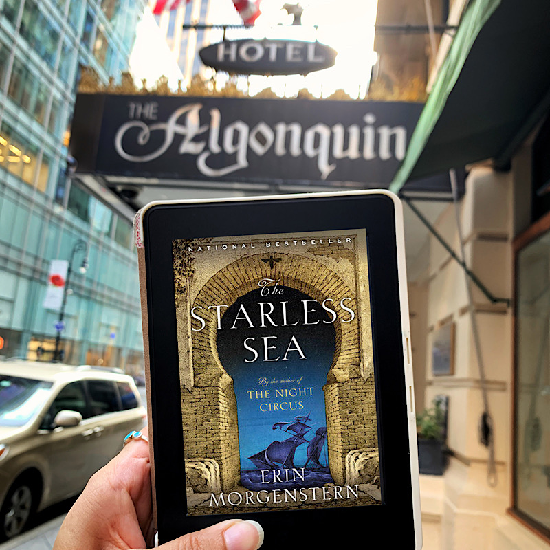 The Starless Sea by Erin Morgenstern in front of The Algonquin Hotel