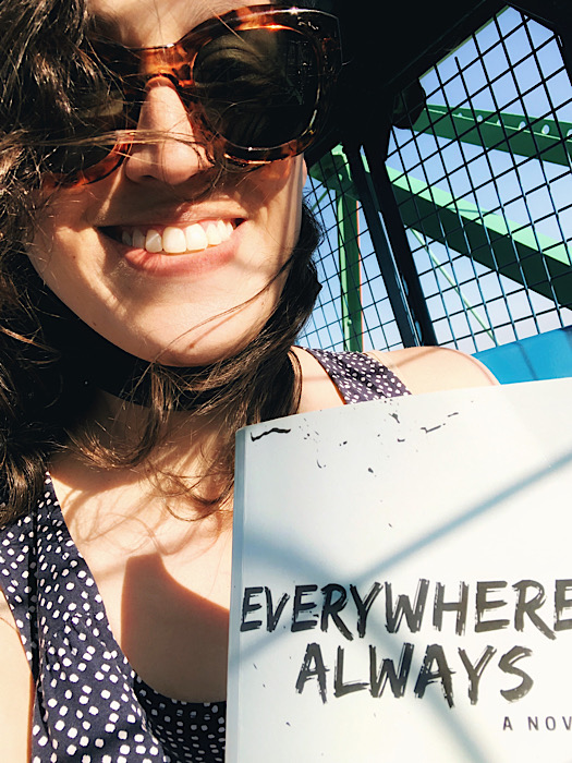 Everywhere, Always tour of New York City, holding the book while on the Wonder Wheel