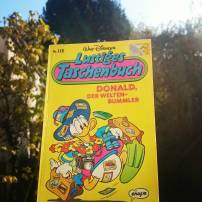 "#fallintoreads Day 13: Happy Books. This is The Ducktales in comic book format. Their title ""Lustiges Taschenbuch"" translates to ""Funny paperbacks"" and there are hundreds of them, each containing about 3 stories. They're fun and a big part of my childhood - this one is from 1990. #lustigestaschenbuch #Ducktales #funnybook #comic #graphicnovel #childhoodmemories #Bookstagram #Disney #donaldduck ©theliteratigirl"