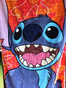 Beach towel with alien on it.