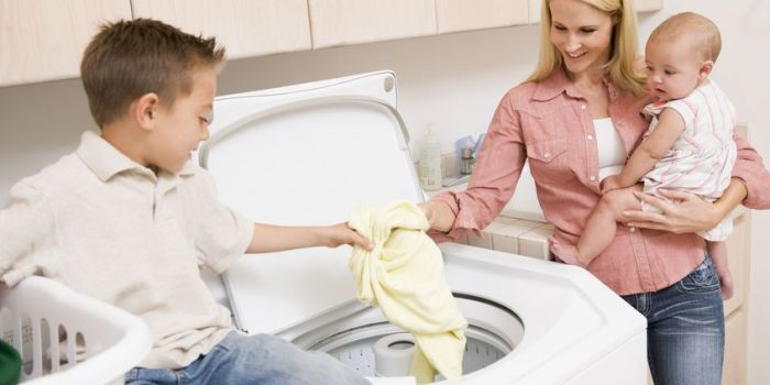 4444842 - Mother And Children Doing Laundry