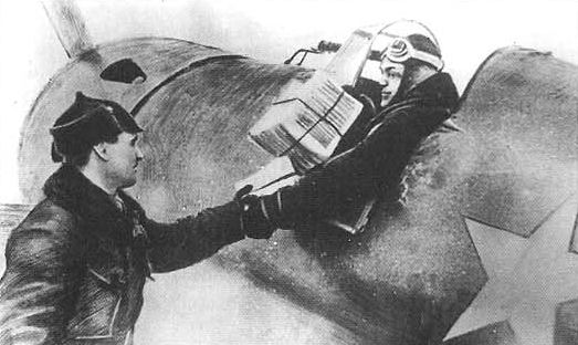 Старший политрук А.А.Ивашкин берет в кабину своего И-16 пачку листовок. 1939 год