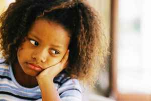 little angels inc girl looking sad