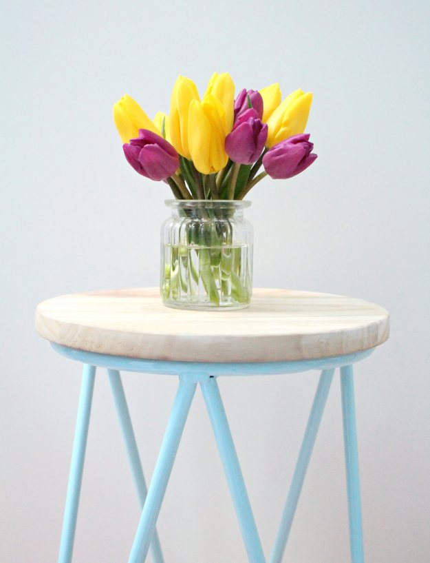 Pretty-tulips-on-blue-stool-photo-by-Geraldine-Tan