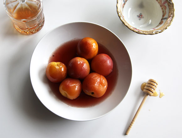 Nectarines poached in honey and black pepper