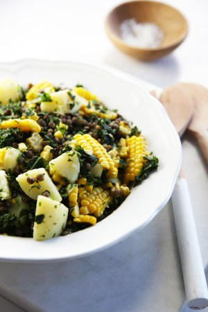 Warm lentil, potato & corn salad with yoghurt dressing
