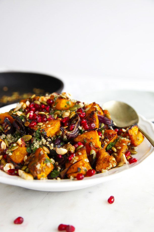 Roasted pumpkin quinoa salad - packed with herbs and garnished with pepitas, pomegranate & hazelnuts