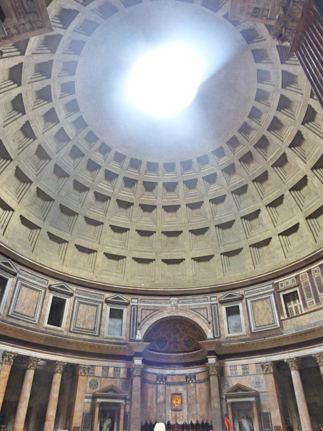 Natural light floods the Pantheon through an opening in its dome