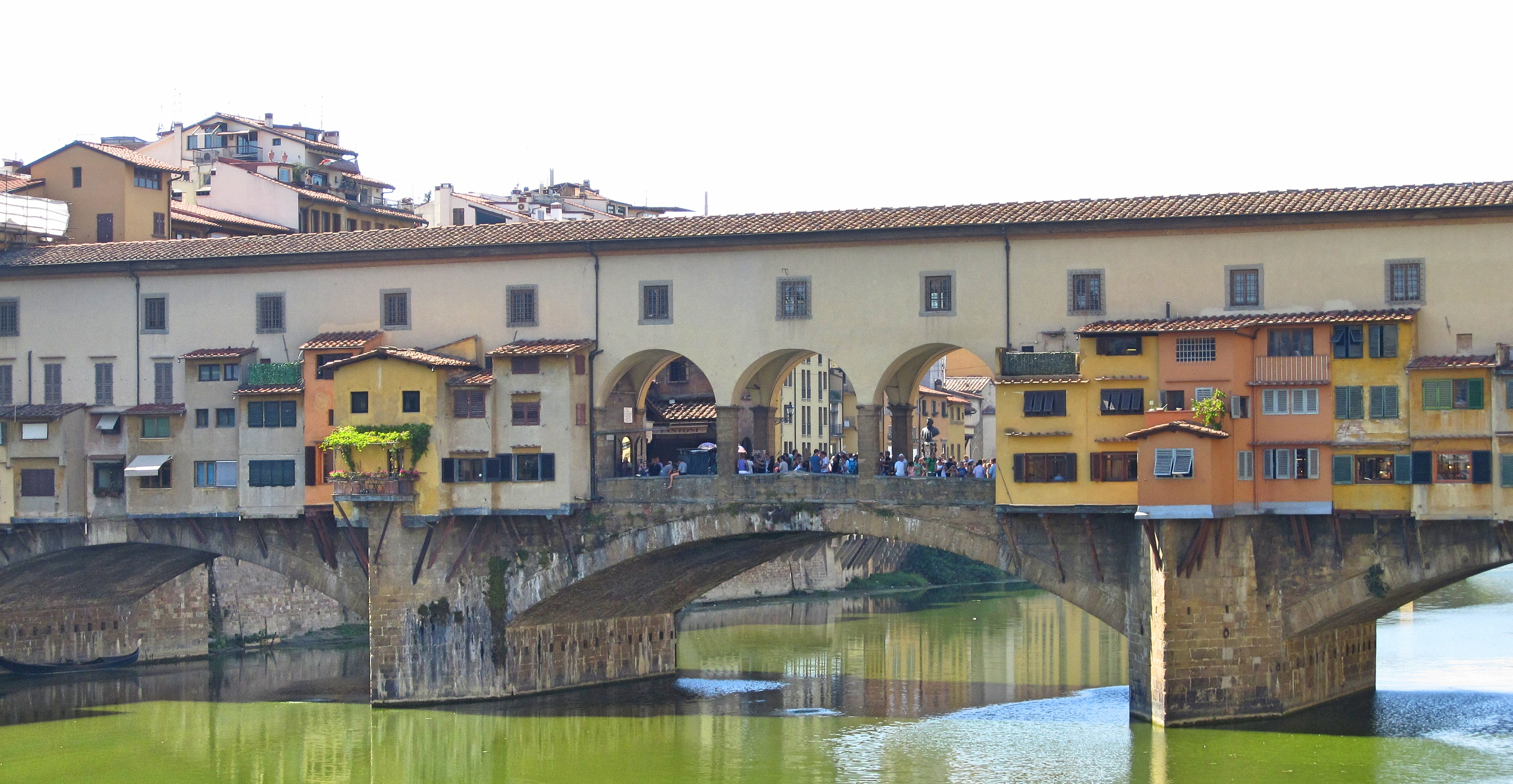 The Ponte Vecchio that stretches over the Arno river still has little shops on it.