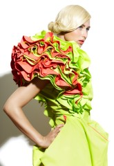 Beautiful woman wearing green dress with frills. ** Note: Soft Focus at 100%, best at smaller sizes