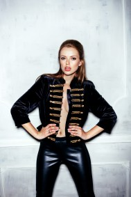 Fashion portrait of young sexy woman with hairstyle wearing vintage military hussar uniform