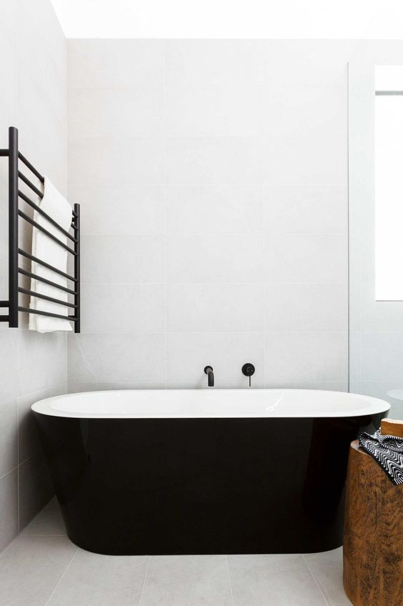 via remodelista black tub and towel warmer