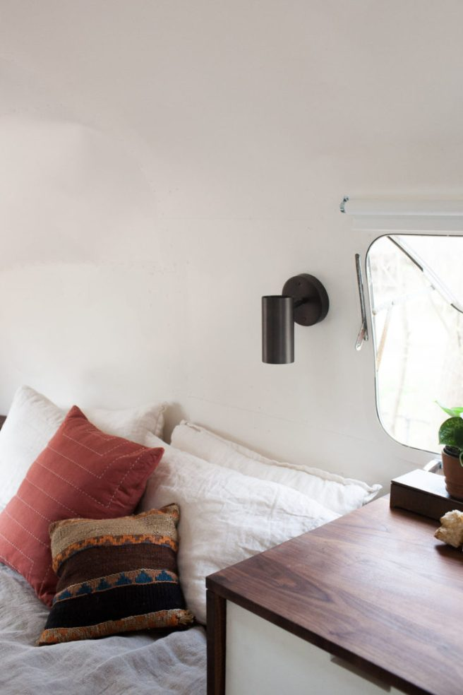 modern-caravan-airstream-remodel-bed-1-733x1100.jpg
