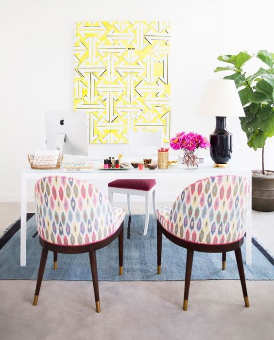 my domaine large yellow geometric art in home office, white desk and multi print fabric on side chairs