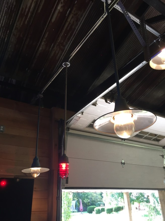 Industrial Lighting In Barn, Lighting Over Bar In Man Cave, Recycling Light Fixtures