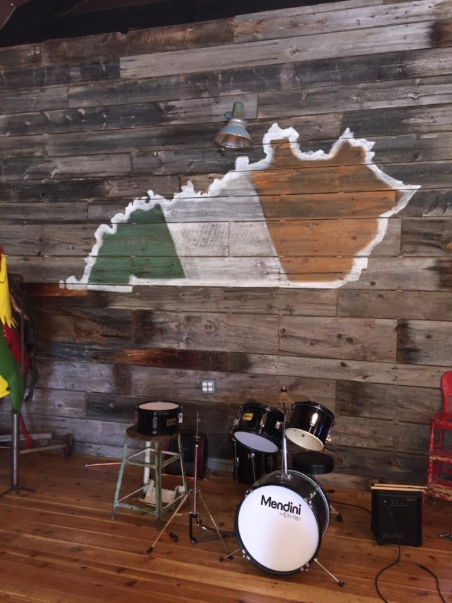 Stage with Drum Set, Painted Barn Wood, My Old Ky Home and Ireland