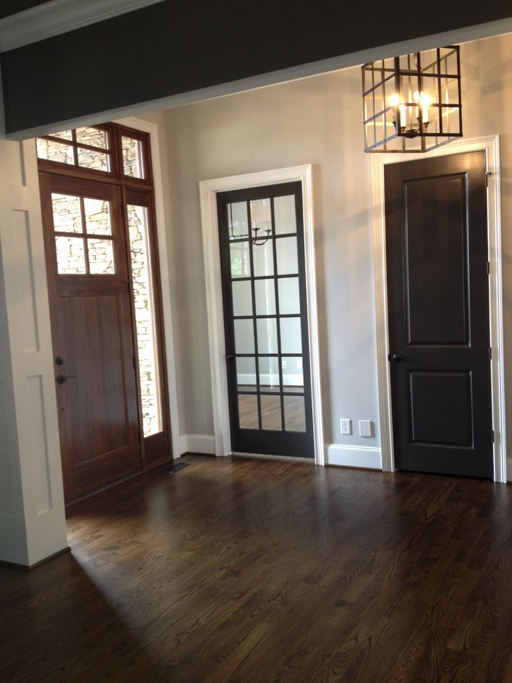 Walnut Wood Flooring, Pale Gray Wall Color, Iron Lantern, Craftsman Architecture