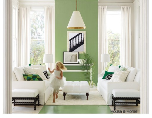 Living Room with white sofas, pickle green walls, green painted wood floor