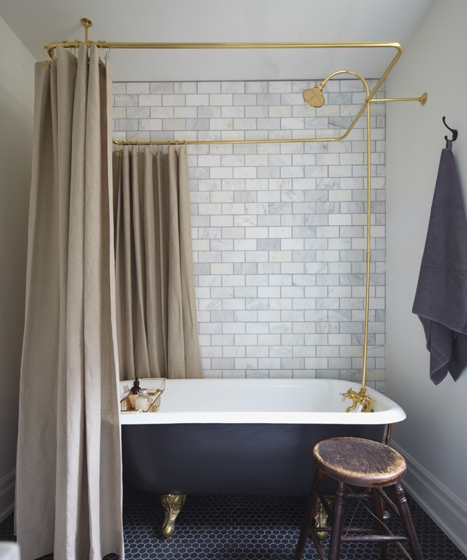Vintage Cast Iron Tub, Brass Plumbing Fixtures and Shower Curtain Enclosure, Gray and Cream Marble Subway Wall Tile, Black Hexagon Tile Floor