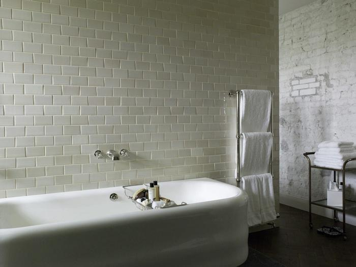 Cast Iron Vintage Tub, Exposed White Washed Brick in Bath, Chrome Towel Warmer, Bar Cart As Towel Stand