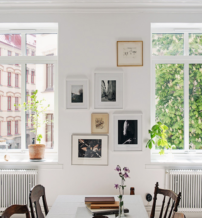 Small Mixed Frame Gallery Art Wall, Radiators Under White Frame Windows, Breakfast Nook