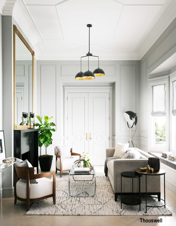 High Ceiling Room with Applied Moldings, Modern Black and Gold Light Fixture, Light Gray with Black and White Color Palette
