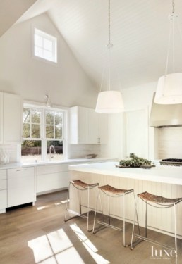 natural wood floor, all white kitchen, white walls, white cabinets, white counter tops, headboard ceiling-via luxe