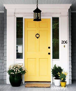 ohlovely! gives us a remarkable example of how welcoming a yellow front door can be