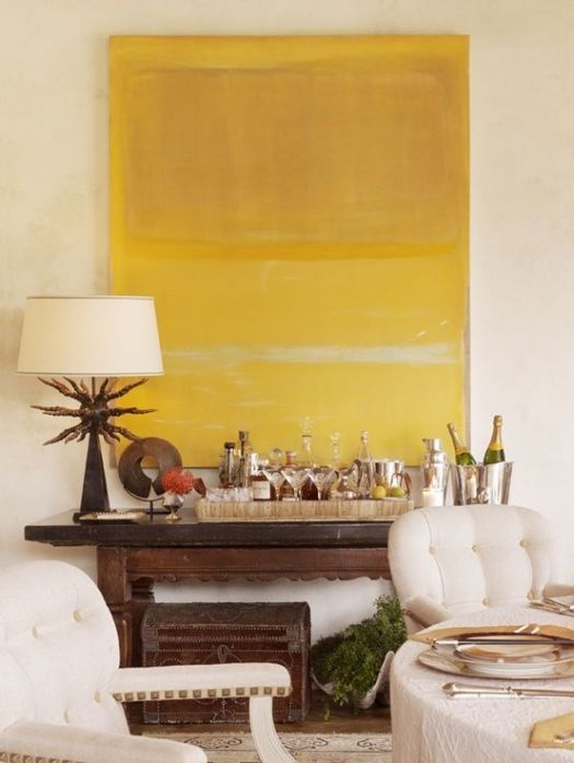pinterest large yellow wall art and wood console table with bar tray of shinny chrome buckets and glass liquor bottles