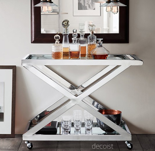 """decoist chrome """"x"""" bar cart with glass decanters of warm bourbons"""