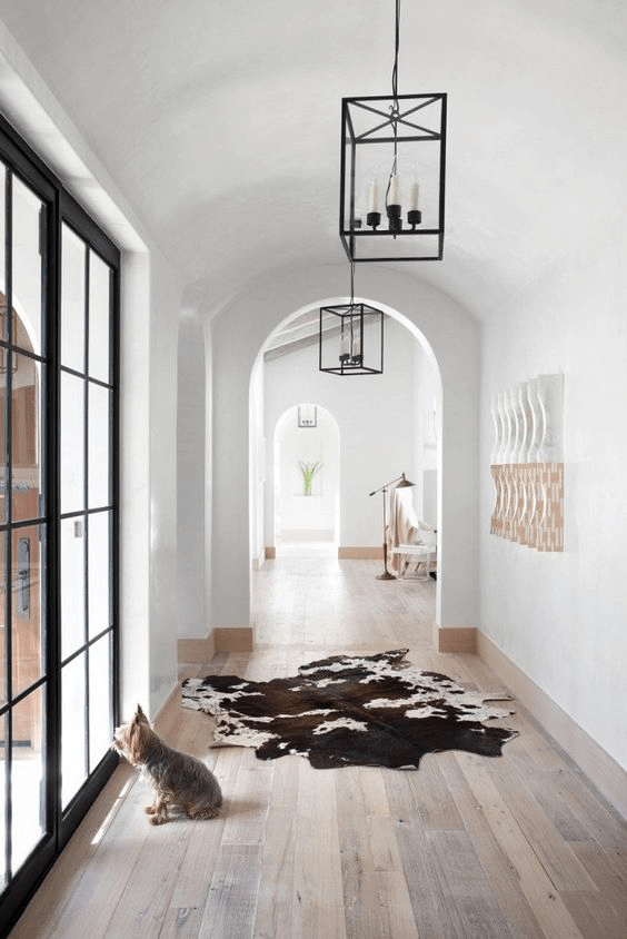 Warm Washed Floors and Doors With Black Accents Are Perfect Backdrops For Lantren Lighting-image via pinterest