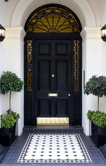 Black and Brass...Always a winning combination for a homes exterior.-via pinterest
