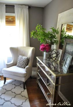 guest bedroom with mirrored dresser and linen wing chair - dear lillie