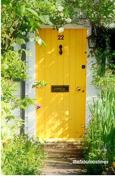 Yellow Plank Front Door Makes Such A Welcoming Entry-via the fabulous times