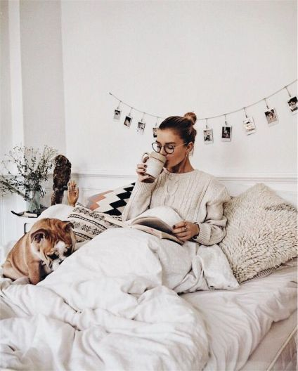 Gal curled up in bed with cup of coffee, doggie and reading a book.-via pinterest