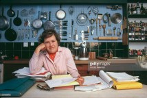 Julia Child in Kitchen with Blue Pegboard